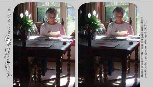 Evan Lindquist artist-printmaker, stereoview card, Sharon drawing at table