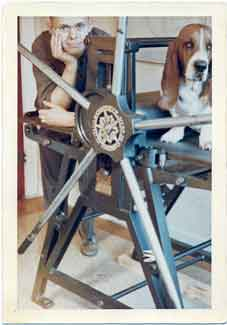 Evan Lindquist with etching press and dog, 1964