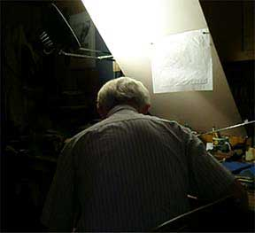 Evan Lindquist artist-printmaker, view of the artist at work in his studio while engraving a copper plate